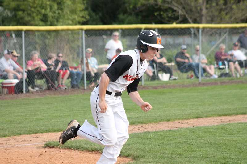 PIONEER PHOTO: CONNER WILLIAMS  - Molalla freshman Linden Mackenzie takes off for first base during the Indians' play-in game against Junction City last Thursday.