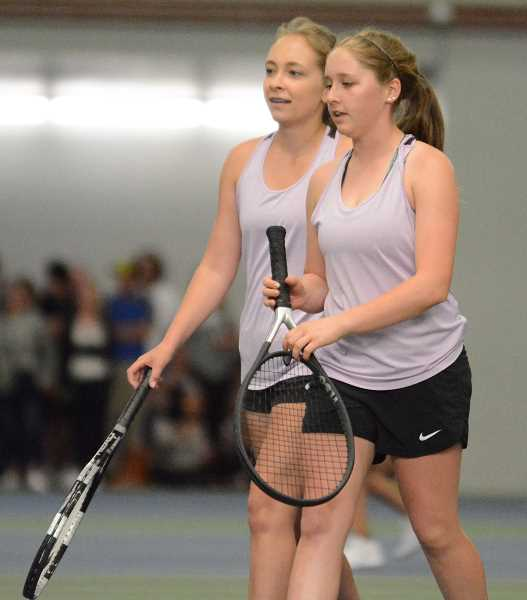 PAMPLIN MEDIA GROUP PHOTO: DAVID BALL  - Molalla seniors Jessa Donaldson (left) and Rachel Norgren during theirfirst-round match in the state tennis tournament Saturday.