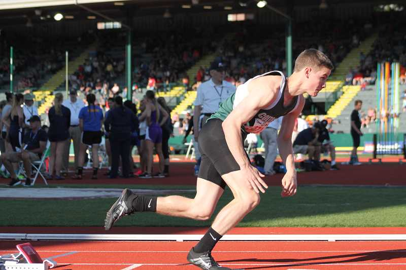 PIONEER PHOTO: CONNER WILLIAMS  - Colton junior Evan Rasor takes off from his block in the 400m dash finals race to take second at state Friday.