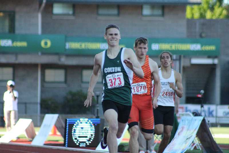 PIONEER PHOTO: CONNER WILLIAMS  - Colton junior Evan Rasor crosses the finish line in the 400 meter dash to take second at the state meet Friday.