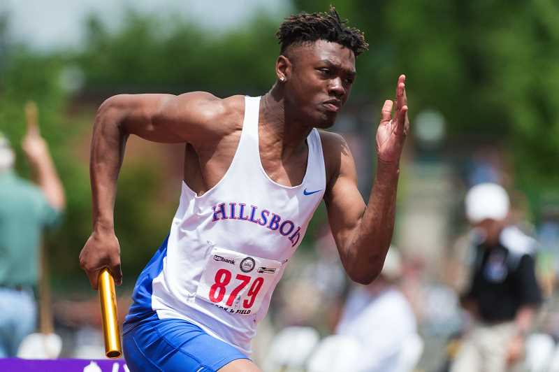 HILLSBORO TRIBUNE PHOTO: CHRISTOPHER OERTELL - Hillsboro's Daekwon Mitchell runs with the baton during the 4x100 relay at the OSAA 5A State Track and Field meet in Eugene last weekend.