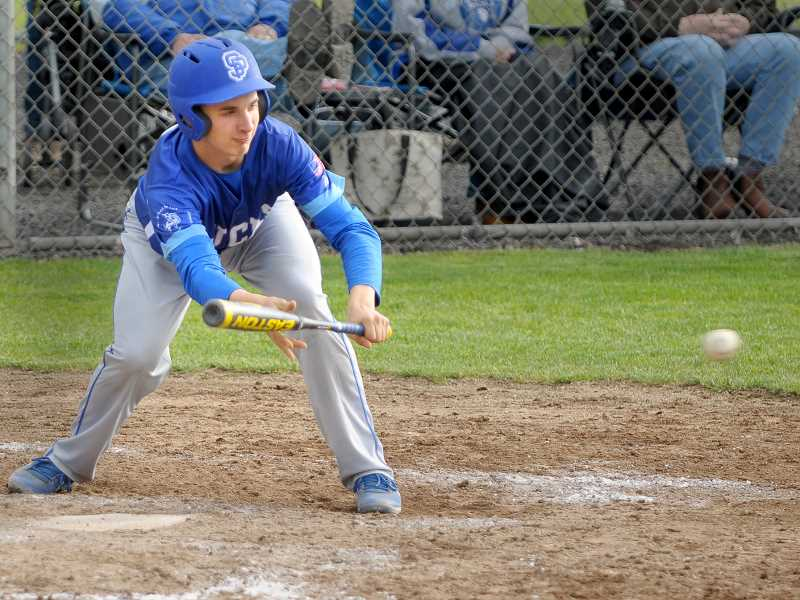 SETH GORDON - Sophomore Zach Brentano lays down a bunt during St. Paul's 5-4 home loss to Regis May 17. Brentano's bunt was one of three consecutive bunts that helped St. Paul rally for two runs in the bottom of the sixth to tie the game and force extra innings.