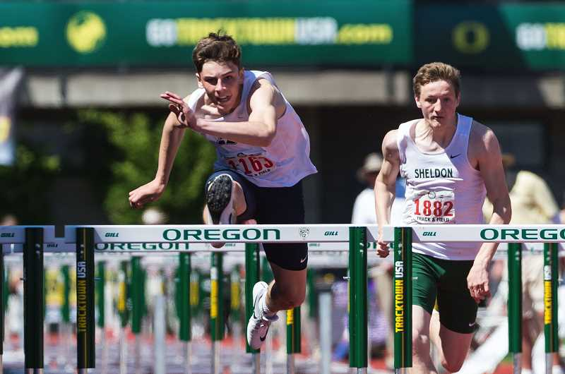HILLSBORO TRIBUNE PHOTO: CHRISTOPHER OERTELL - Liberty's Aidan Maloney leaps over a hurdle during the OSAA 6A State Track and Field Championships, May 20 at Hayward Field in Eugene.