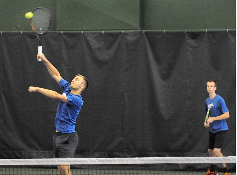 SETH GORDON - Senior Jasper Riogeist smashes an overhand to win a point during he and doubles partner Matt Weiler's 6-1, 6-2 win in the opening round of the state tournament Thursday at the Tualatin Hills Recreation Center.