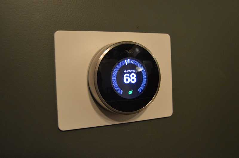 SPOTLIGHT PHOTO: COURTNEY VAUGHN - Nest is one product line that provides smart home security and climate control systems, such as the pictured smart thermostat. The thermostat over time 'learns' the daily activities of your household, automatically adjusting to meet your needs and — ultimately — bringing savings to your utility bills.