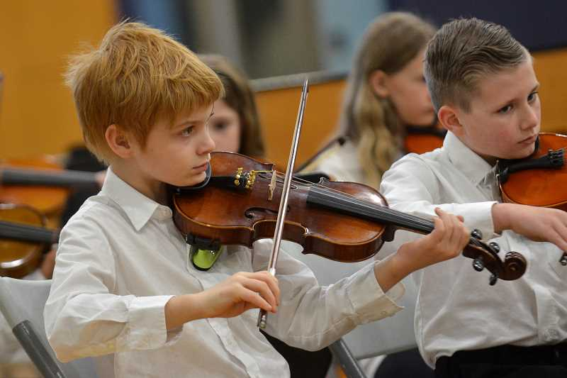 SPOKESMAN PHOTO: VERN UYETAKE - Elementary-aged students played the violin, viola and cello during their finale concert Wednesday, May 17 at Wilsonville High.