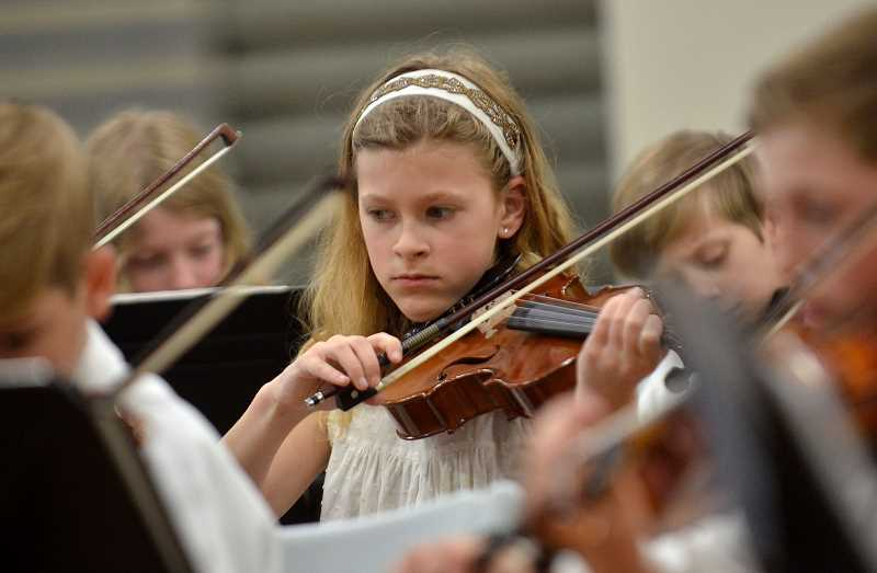 SPOKESMAN PHOTO: VERN UYETAKE - Wednesday's performance marked the last of the year for the school district's strings students.