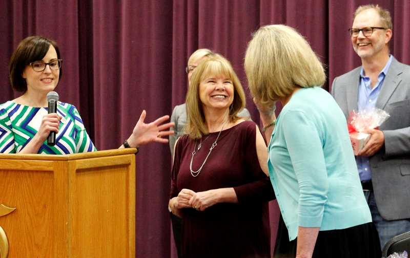 TIDINGS PHOTOS: ANDREW KILSTROM - Stafford Principal Sara McCarney, left, congratulates Joann Madsen-Fordyce, middle, and Julie Wilhelm on their retirements.
