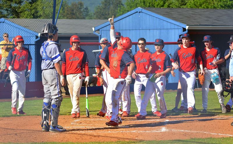 TIMES PHOTO: MATT SINGLEDECKER - Westview junior Mante Woods banged a game-tying solo homer against Grants Pass to tie up the first round of the Class 6A playoffs on Monday.
