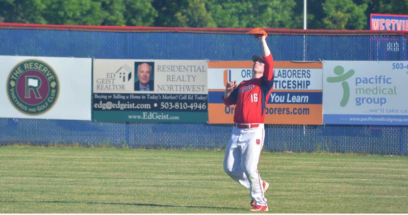 TIMES PHOTO: MATT SINGLEDECKER - Westview senior outfielder Keegan Huey-Woods hangs on to the final out of the first round of the 6A playoffs.