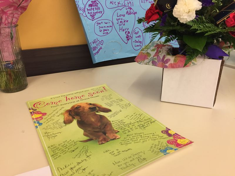 ESTACADA NEWS PHOTO: EMILY LINDSTRAND - Residents at Grace Place signed a card for Wagner wishing him the best in his recovery. The card is one of many at Harvest Market.