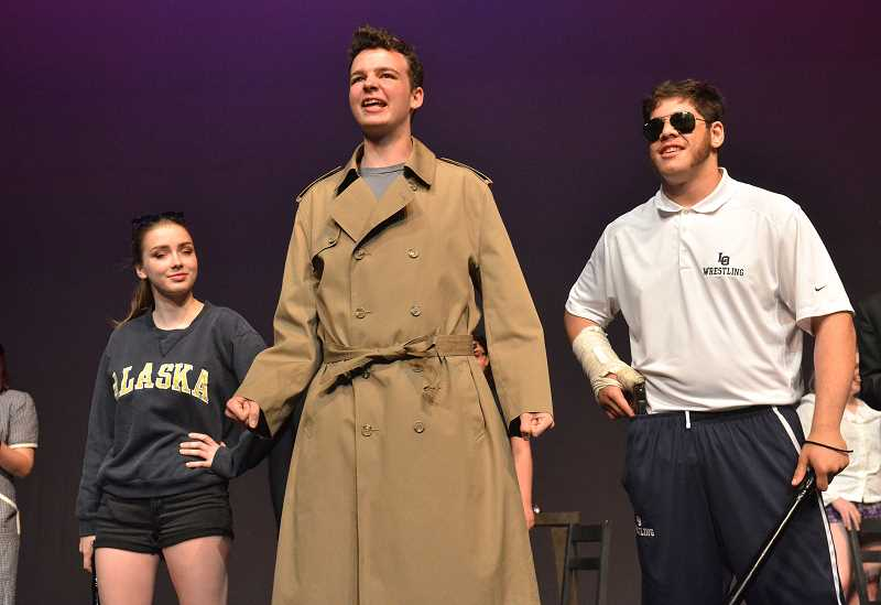 REVIEW PHOTO: VERN UYETAKE - A few Keystone cop-like characters are looking to solve a mystery. From left are: Julia Donahue, Gannon Connelly and Sina Ansari