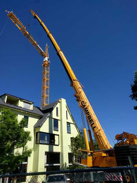 REVIEW PHOTO: ANTHONY MACUK - Crews spent Monday assembling an 'assist crane' in front of Peet's Coffee on First Street in Lake Oswego and part of Wednesday taking it apart again. In between, they removed the 212-foot-tall tower crane that had stood at First Street and A Avenue for months.