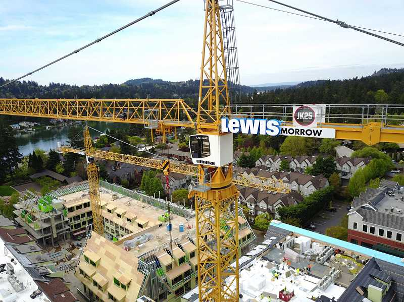 REVIEW PHOTO: ALVARO FONTAN  - Before it was dismantled, the 212-foot-tall crane that towered over the Wizer Block's northeast corner offered stunning views of downtown, Oswego Lake and beyond.