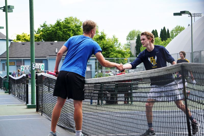 PHOTO CREDIT: AMY GADBOIS - Gilje shakes hands with Hood River Valley junior Sawyer Bogard 6-3, 6-0 in the first round of the Class 5A state boys' singles tournament on Thursday, May 18, at the Portland Tennis Center.
