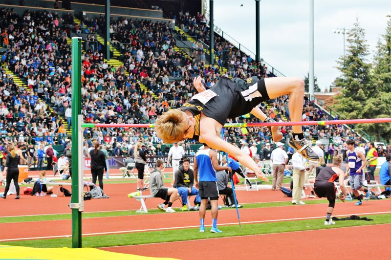 SPOTLIGHT PHOTO: JAKE MCNEAL - Lions junior Dakotah Camberg won the boys' high jump with a personal-best 6-foot, 6-inch leap over Hermiston senior Hiram Maciel (6-5) and Thurston junior Tyson Haas (6-4).