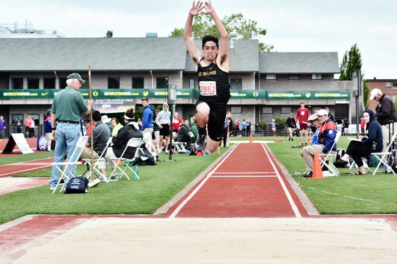 SPOTLIGHT PHOTO: JAKE MCNEAL - Lions junior Daniel Lujano lept to second in the boys' triple jump at a personal-best 45 feet, 3.25 inches to defending champion and Churchill senior Samuel Jackson (47-.5) and ahead of Summit junior Ryan Tennant (44-9.5) and fifth in the 110 hurdles (15.47) to Silverton senior Brock Rogers (14.47), Hermiston junior Tyler Rohrman (14.68), Crater junior Cal Duke (14.79) and La Salle Prep senior Jordan Gloden (15).