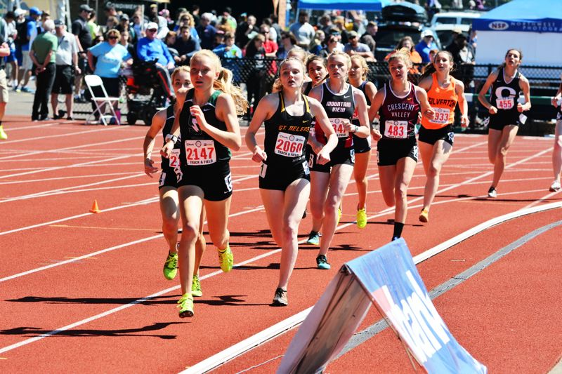 SPOTLIGHT PHOTO: JAKE MCNEAL - Lions senior Josie Hanna, third from left, came up fifth in the girls' 800-meter run in 2 minutes, 23 seconds to Summit senior Emma Stevenson (2:17.75) and freshman Isabel Max (2:18.45) Crescent Valley (Corvallis) sophomore Geneva Wolfe (2:22.40) and Marist Catholic sophomore Rainy Adkins (2:22.67) and helped Sophia Estep, Isabelle Wallace and Cheyenne Trainer to 11th in the 1,600 relay (4:14.62).