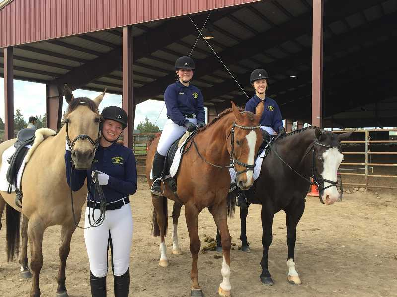 SUBMITTED PHOTO -  Dressage riders Maisie Rowley, Laney Augustus and Julia Forell, who swept medals at districts, pose for a photo.