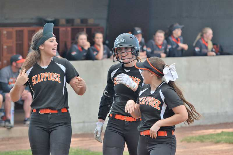 SPOTLIGHT PHOTO: JAKE MCNEAL - Indians junior Hannah Galey, center, celebrates her Scappoose High single-season-record 14th home run with junior Hadley Enos, left, and senior Nicole Lukinbeal, right, in the third inning of the Tribe's 12-2, six-inning Class 4A first-round win on Wednesday at the Y-C Partners Softball Complex at Yamhill-Carlton High School in Yamhill.