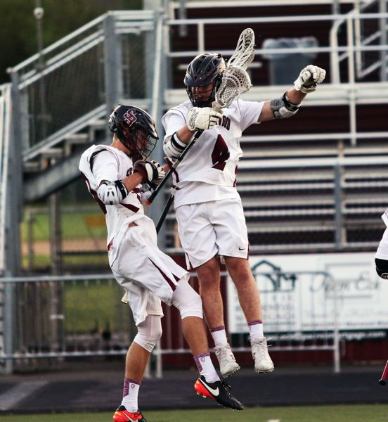 DAN BROOD - Sherwood's Ryan Stuckey (left) and Cameron Allender celebrate a Bowmen goal during Tuesday's state playoff game.