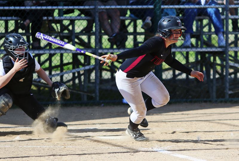 DAN BROOD - Tualatin senior Amanda Reser went 4 for 4 at the plate in the Wolves' 7-1 win over McMinnville on Wednesday.