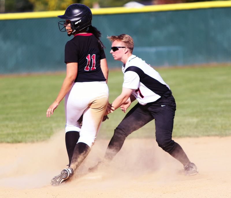 DAN BROOD - Tualatin junior Zoe Olivera (left) is safe at second base as she hit a two-run, first-inning double in the 7-1 playoff win over McMinnville.