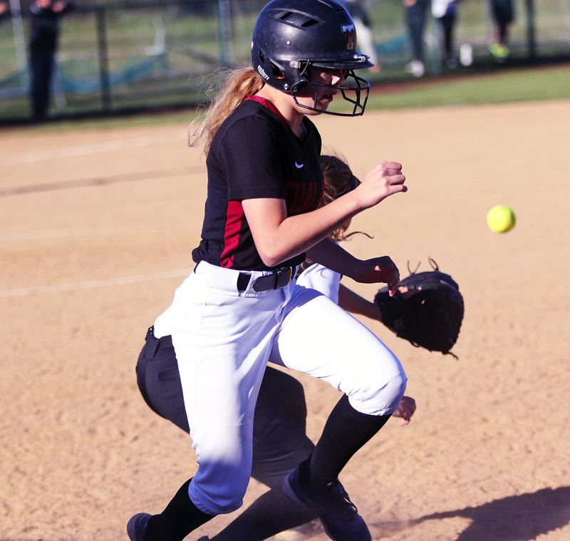 DAN BROOD - Tualatin junior Kayla Laird beats the throw to first base for a sixth-inning infield single during Wednesday's state playoff game.