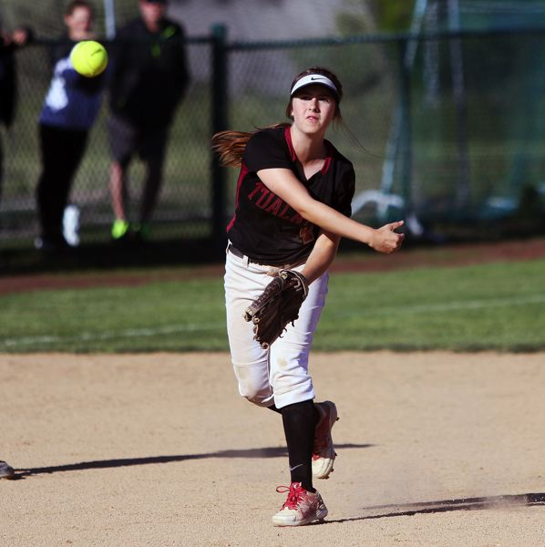 DAN BROOD - Tualatin freshman shortstop Bella Valdes makes a throw to first base during the Wolves' 7-1 win over McMinnville.