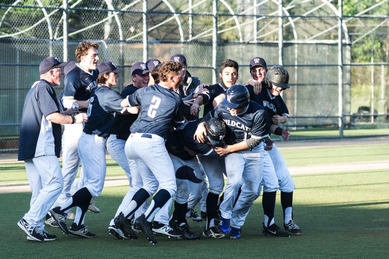 SUBMITTED PHOTO: GREG ARTMAN - Wilsonville baseball players celebrate after defeating Summit 7-6 in the first round of the playoffs Wednesday, May 24 at Wilsonville High School.