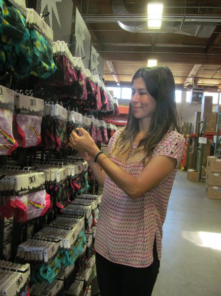PHOTO BY ELLEN SPITALERI - Carrie Atkinson, founder of Sock It to Me, checks out a rack of underwear that matches many of the patterns on the company's fun and funky socks.