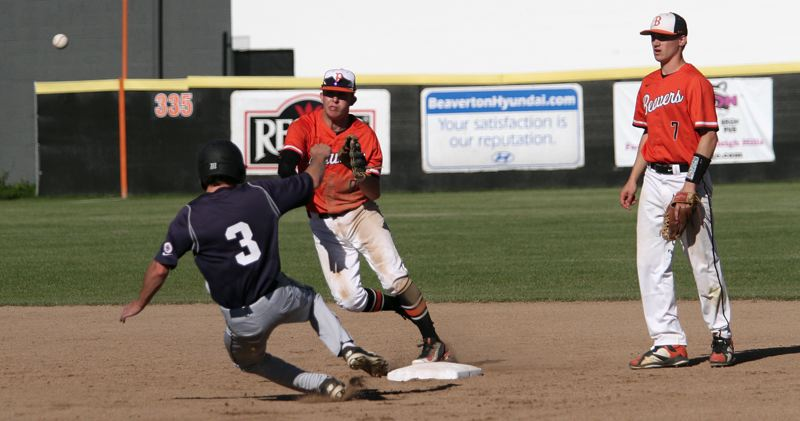 PMG PHOTO: MILES VANCE - Beaverton shortstop Karac Leyva turns a double play with Lake Oswego's Matt Sebolsky sliding in during the Beavers' 9-6 home win over the Lakers in the Class 6A state quarterfinals on Friday.