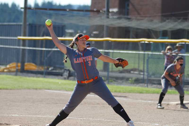 NEWS-TIMES PHOTO: WADE EVANSON - Gladstone's Madi Mott winds up to throw a pitch during Gladstone's game versus Banks Friday, May 26 at Banks High School.