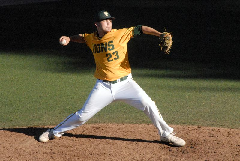 PMG PHOTO: MATT RAWLINGS - West Linn's Rance Pittman cranks it up during his team's 8-1 win over Gresham in the Class 6A state quarterfinals on Friday at West Linn High School.