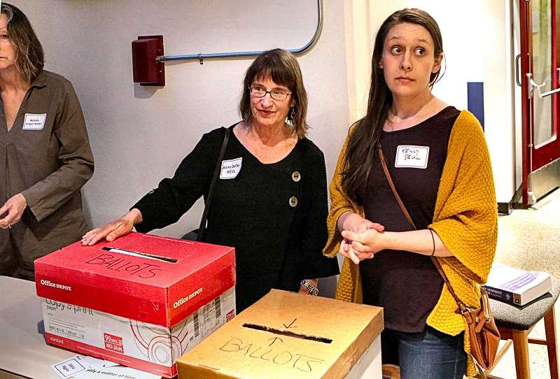DAVID F. ASHTON - Southeast Uplift Director Annie Dufay and worker Kelly Fedderson monitored the election, keeping careful watch over the ballot boxes.   Eastmoreland vote_006.jpg  Photo by David F. Ashton  Over one thousand Eastmoreland neighbors came to Reed College to attend the ENA Annual Meeting and vote for new Board Members.