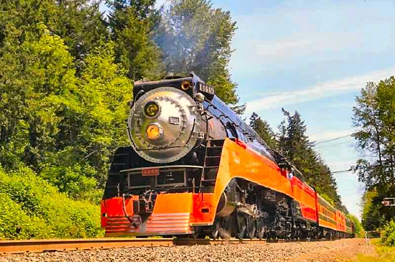 COURTESY OF JIM THOMAS - Historic locomotive SP 4449 rumbles through Lake Oswego on its way to Tigard on May 9th. On board for the special trip: The retiring chairman of Genesee & Wyoming Inc., Mortimer B. Fuller III.