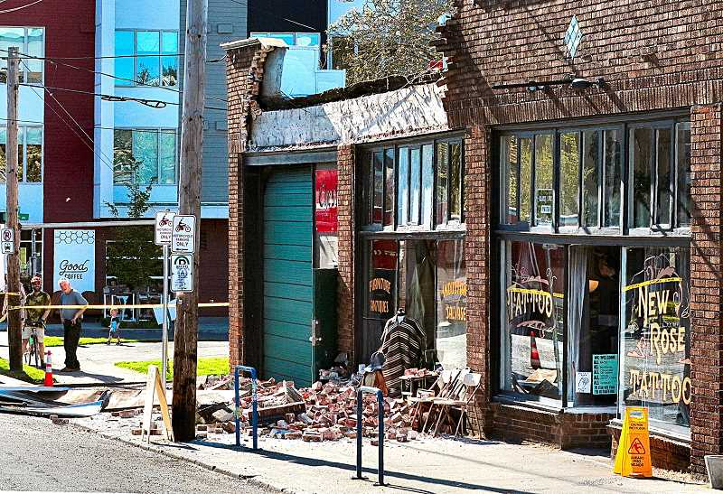 DAVID F. ASHTON - Three businesses were temporarily closed, just east of S.E. 48th Avenue at Division Street, after façade bricks and parapet pieces showered down onto the sidewalk in front of them on May 3rd.