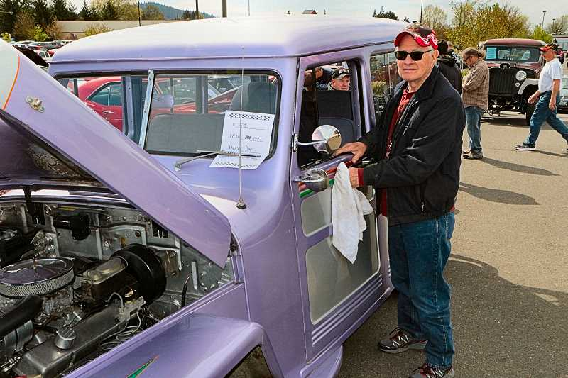 DAVID F. ASHTON - Leonard Waugh polishes up his 52 Willys Wagon at the temporarily-new location of 82nd Avenue of Roses Cruise-In.