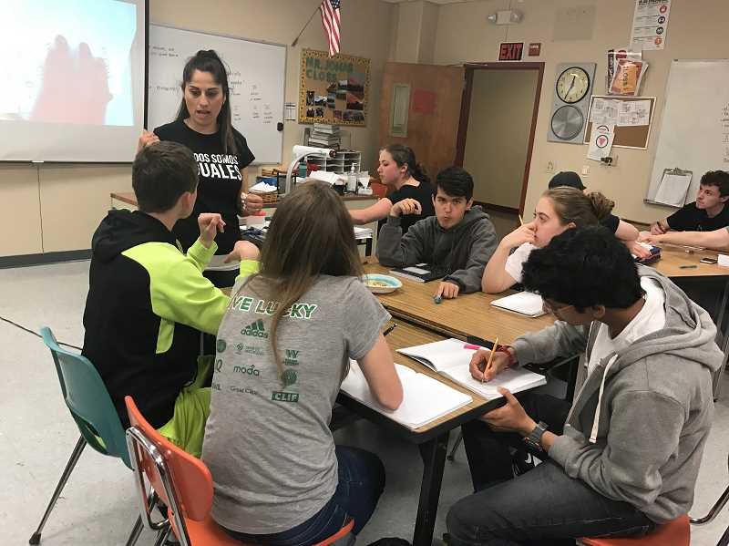 COURTESY PHOTO - Claudia McClellan (standing) works with a small group at Century High School, where she was a teachign assistant.