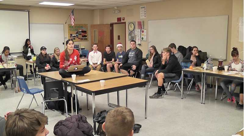 COURTESY PHOTO - Claudia McClellan sits on a table as she talks to students at Century. She hopes to inspire young, struggling immigrants to pursue their own dreams.