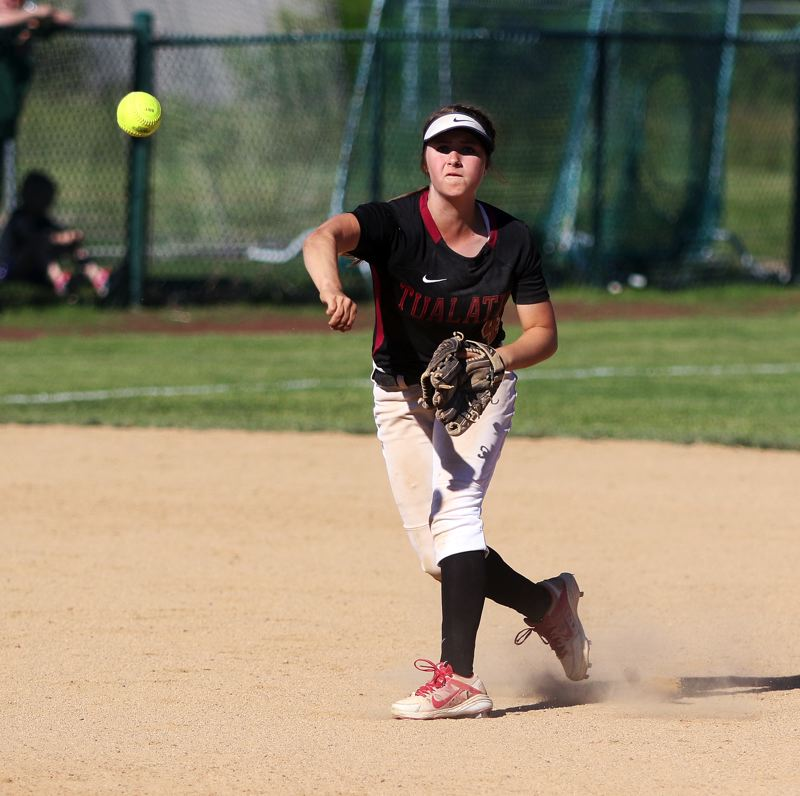 DAN BROOD - Tualatin freshman shortstop Bella Valdes makes a throw to first base during the Wolves' quarterfinal win over Grants Pass.