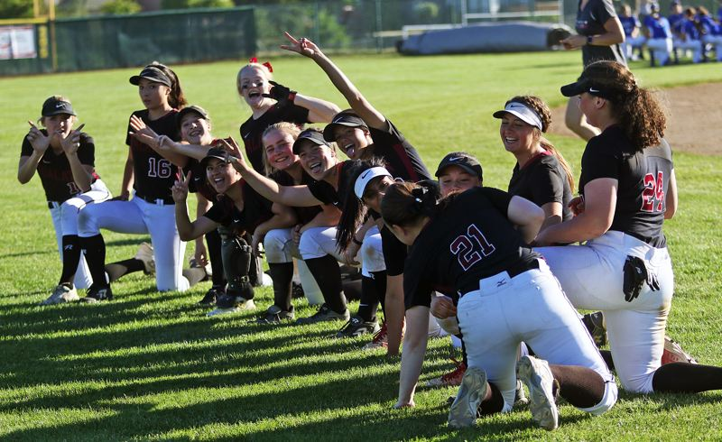 DAN BROOD - The Tualatin High School softball team is all smiles following the 4-0 win over Grants Pass.