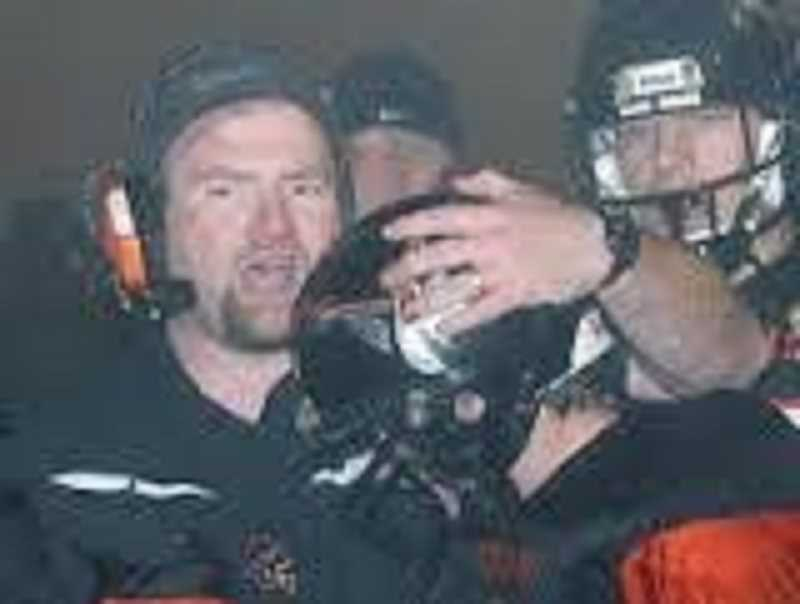 PHOTO COURTESY OF MOLALLA RIVER SCHOOL DISTRICT  - Tim Baker (left) in his last game as Molalla High School's head football coach in 2006.