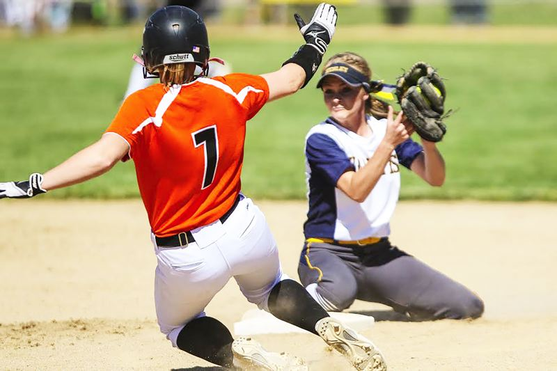 PHOTO CREDIT: JOAQUIN AGUILAR-FLORES - Indians junior Nicole Dougherty, left, slides into second base.