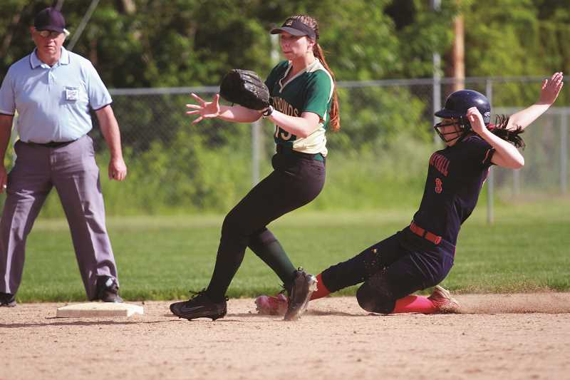 PHIL HAWKINS - Kennedy senior Emily Frey slides into second in the opening inning of the Trojans' 15-2 win over Gaston in the first round of the 2A/1A state playoffs on May 24. Frey went 2-for-4 with a pair of RBIs in the victory.