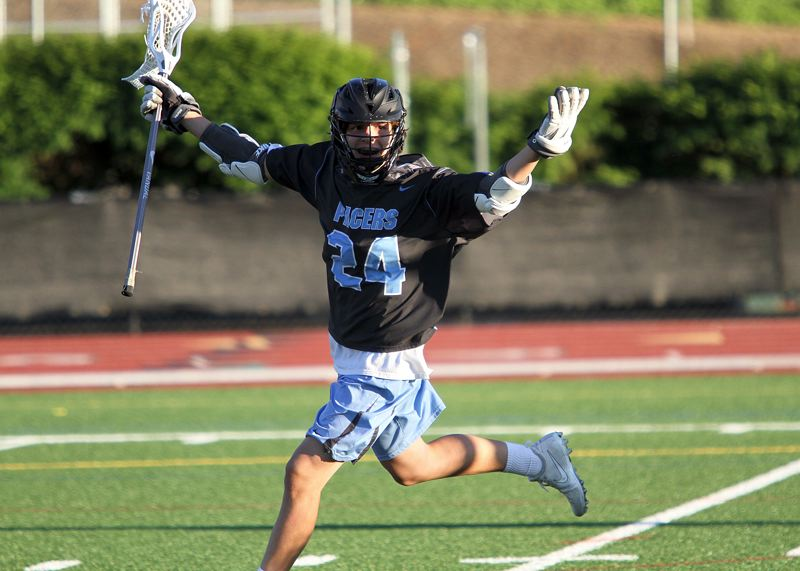 REVIEW PHOTO: MILES VANCE - Lakeridge sophomore Hunter Daskalos celebrates a goal during the Pacers' 11-10 playoff loss at Jesuit High School on Friday.