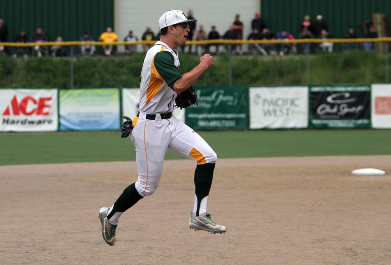 PMG PHOTO: MILES VANCE - West Linn senior shortstop Tim Tawa leaps into the air at the end of his team's 3-1 win over Beaverton in the Class 6A state semifinals at West Linn High School on Tuesday.