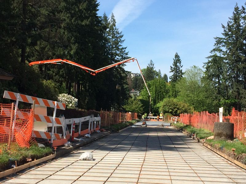 SUBMITTED: PORTLAND PARKS & RECREATION - Concrete pouring vehicles use a giant hose and crane to pour into the garden from above.