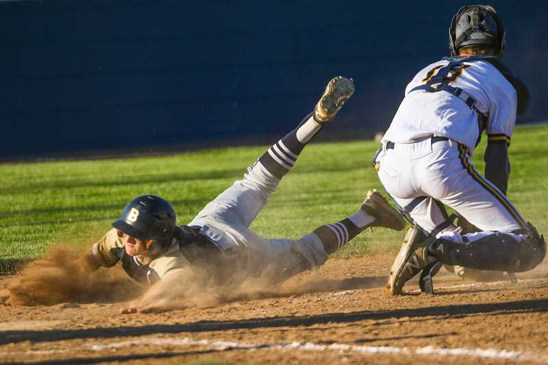 COURTESY PHOTO - Banks' Gunnar Partain slides home during the Braves' game against Henley in the state baseball quarterfinals last Friday.