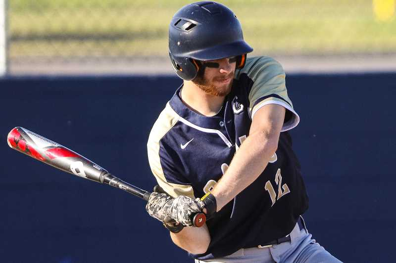 COURTESY PHOTO - The Braves' Jake Evans takes a swing during a May 26 state quarterfinal game against Henley High School.